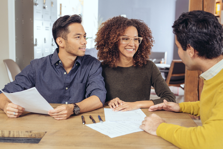 Couple comparing mortgage interest rates financial advisor